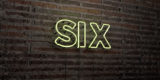 SIX -Realistic Neon Sign on Brick Wall background