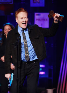 Conan O'Brien accepting his show's award for Best Comedy Podcast
